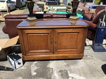 E T Cabinet sold wood w/ glass top in Fort Lewis, Washington