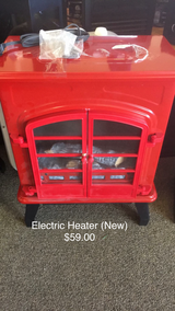Red Heater Fireplace (New) Electric in Fort Leonard Wood, Missouri