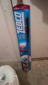 Zebco ultralight fishing pole and tackle box in Byron, Georgia
