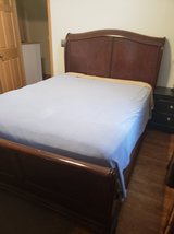 Queen sized Sleigh bed with mattress in Fort Leonard Wood, Missouri