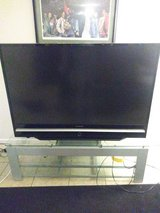 50 inch Samsung tv w/glass table stand in MacDill AFB, FL