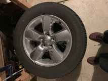 Ram stock wheels and tires w/ original lug nuts in Fort Carson, Colorado