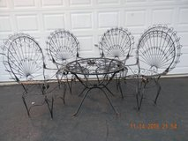 5 PIECE WROUGHT IRON TABLE AND CHAIRS. in Lockport, Illinois