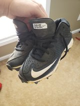 Size 12 youth cleats in Perry, Georgia