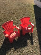 Two kids red chairs in Cochran, Georgia