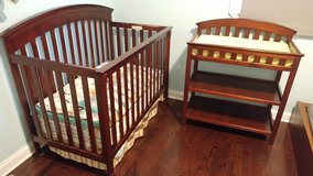 Crib, mattress and baby changing table in Naperville, Illinois