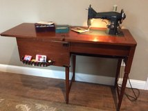 Kenmore sewing machine with wood cabinet in Kingwood, Texas