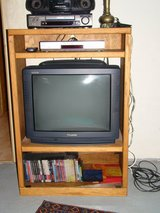 TV stand with top shelf and bottom cubby with glass doors in Spangdahlem, Germany