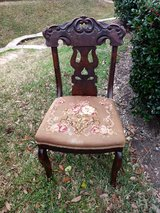 Antique chair with embroidered seat in Conroe, Texas