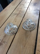 Pair of glass candlestick holders in Lakenheath, UK