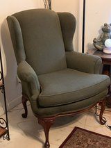 Green accent upholstered chair with wooden legs! in Kingwood, Texas