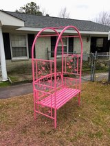 flamingo pink iron bench with arch in Cherry Point, North Carolina