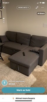 grey sectional pull out couch with storage in Lackland AFB, Texas