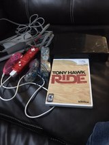 Black Nintendo Wii ..2 controllers, steering wheel  and game in Fort Campbell, Kentucky