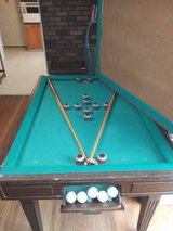Bumper pool table/dinngroom table very heavy including pool stick and balls. in Clarksville, Tennessee