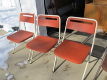 4 Lightweight Orange Plastic Folding Chairs in Yorkville, Illinois