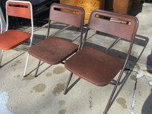2 Lightweight Brown Plastic Folding Chairs in Yorkville, Illinois