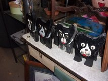 Set of Four Black Wooden Dogs in Fort Riley, Kansas