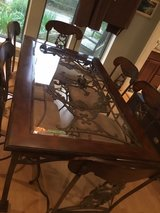 Dining room table with matching buffet included in Spring, Texas