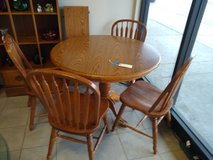 Round oak table and 4 chairs, 1 leaf in Chicago, Illinois