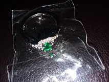 This is a size 8 Beautiful silver dimond ring withan emerald in the middle. in Beaufort, South Carolina