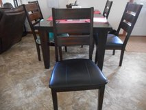 Table and six chairs in Fort Leonard Wood, Missouri