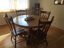 Solid oak pedestal table with 5 chairs in Algonquin, Illinois