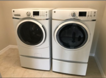 Brand New - Never Used GE Front Load Washer Dryer w/ matching pedestals in Fort Hood, Texas