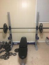 weight bench  & set read description , great deal in Byron, Georgia