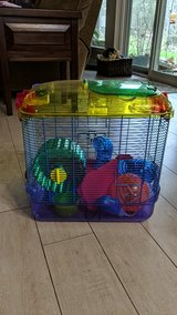 hamster cage with two bags of stuffing and a bag of food in The Woodlands, Texas
