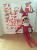 Elf on the shelf with book and collection box in Ramstein, Germany