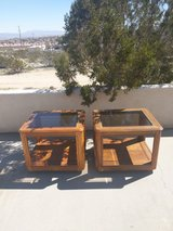 Wooden end tables with glass tops in 29 Palms, California