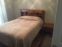 Queen size bed frame and headboard in Conroe, Texas