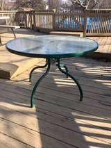 Round glass patio table in Naperville, Illinois