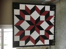 Barn quilt red black and white wood in Clarksville, Tennessee