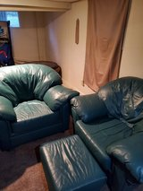 2 green leather chairs with 1 foot stool in Fort Lewis, Washington