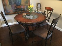 "48"" round x 30"" wood and glass table . Excellent condition , full set with 4 chairs in Wright-Patterson AFB, Ohio"