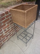 Wicker standing basket on wrought iron in Los Angeles, California