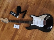 fender guitar + strap and tuner in Joliet, Illinois