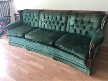 Beautiful emerald vintage couch in 29 Palms, California