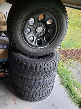 set of 4 BF goodrich 255/75 R17 6 lug wheels and tires for sale came off of my 07 gmc tread decent in Beaufort, South Carolina