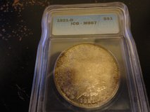 1921 d ms 67 morgan dollar pcgs lists this coins worth at $17,000.00 in Fort Campbell, Kentucky