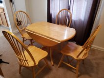 Solid wood kitchen table with 4 chairs in Wright-Patterson AFB, Ohio