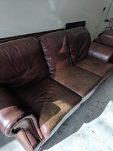 Leather Couch and Chair with Ottoman in Kingwood, Texas