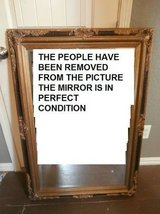 Large antique ornate gold and black wood framed mirror in Kingwood, Texas