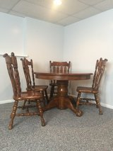 1970s Solid Oak American Classic Pedestal Claw Leg Dining Table with two (2) leaves. in Bartlett, Illinois