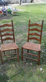 Two vintage cane bottom chairs in Yorkville, Illinois