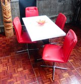 Retro Extendable Dining Room Set wth Red Chairs and a White Table in Ramstein, Germany
