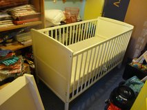 Cot bed and changing station in Lakenheath, UK