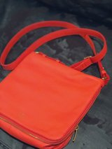 Fossil electric orange all leather cross body handbag with gold hardware in Conroe, Texas